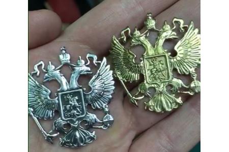 Новые помпезные гербы России